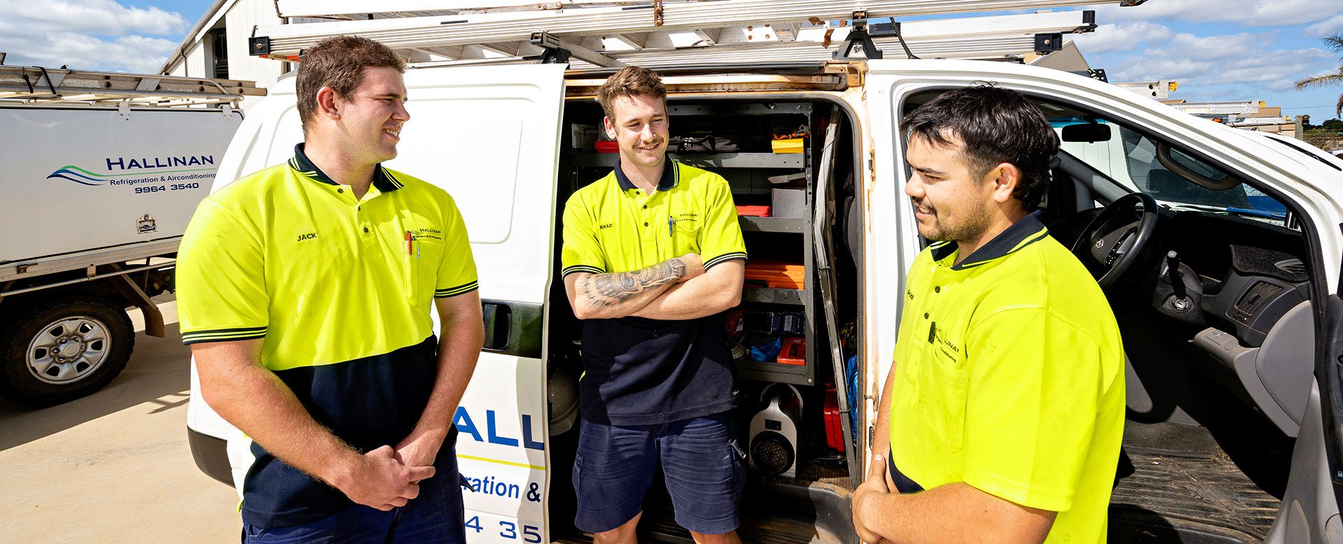 Apprentices talking in front of Hallinan Air Conditioning Head office in Geraldton
