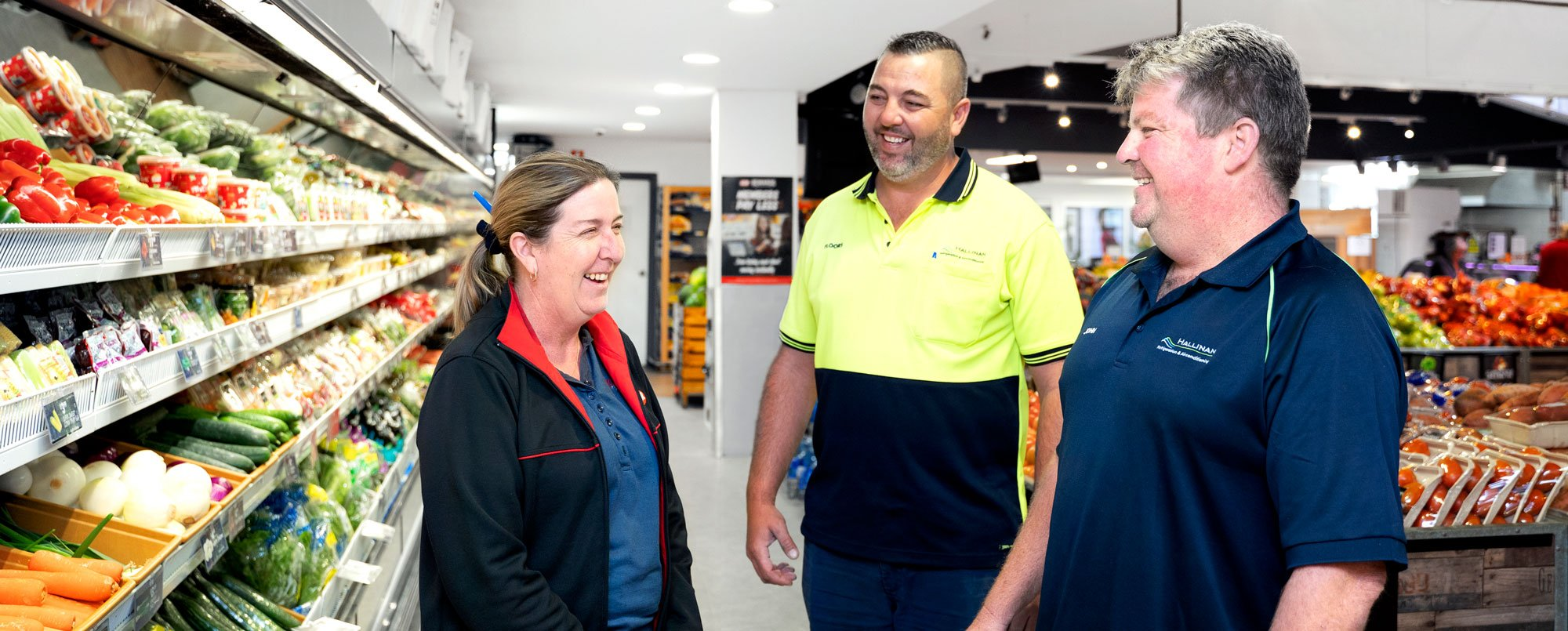 Hallinan staff talking to supermarket manager about refrigeration