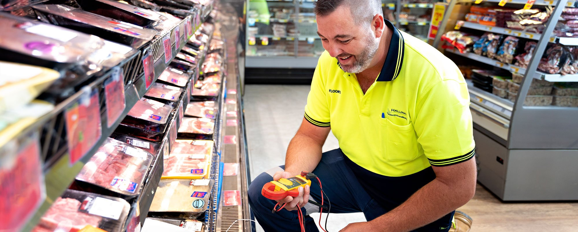 Refrigeration mechanic servicing a chiller at supermarket in Geraldton